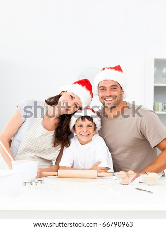 Happy family baking christmas cookies together in the kitchen