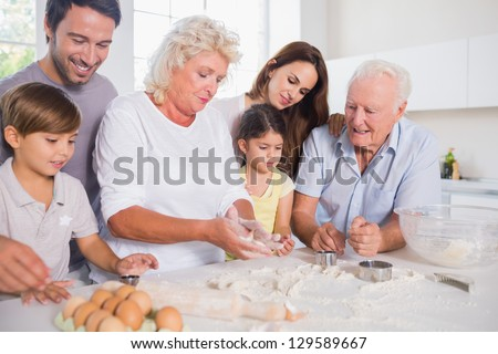 Happy family baking together in the kitchen