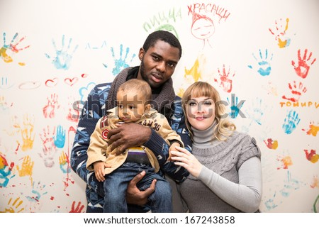 Happy  family: black father, mom and baby boy.Use it for a child, parenting or love concept - stock photo