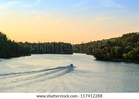 Happy family boating on the Wisconsin River - stock photo