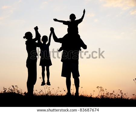 Happy family, boy and girl with mother and father, family at sunset, summertime - stock photo