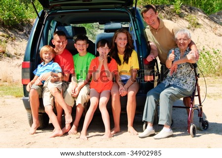 Happy family by car