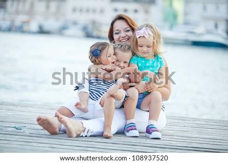 Happy Family by the Sea - stock photo