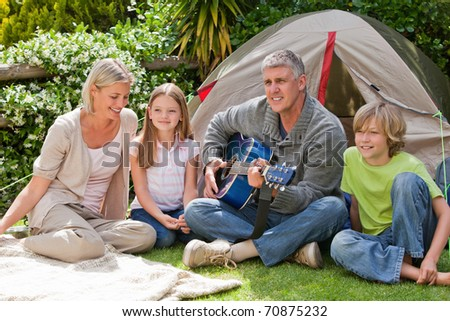 Happy family camping in the garden - stock photo