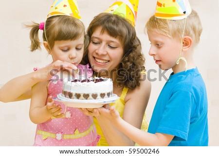 Happy Family celebrates birthday with a cake - stock photo