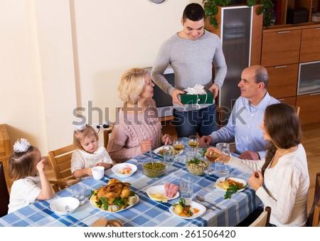 happy family celebrating birthday at festive dinner today - stock photo