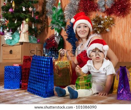 Happy family celebrating Christmas in living room - stock photo