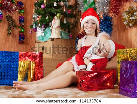 Happy family celebrating Christmas in living room - stock photo