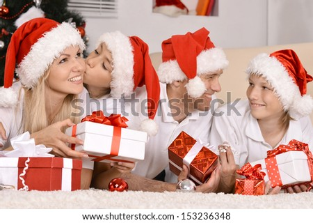 Happy family celebrating the New Year at home - stock photo