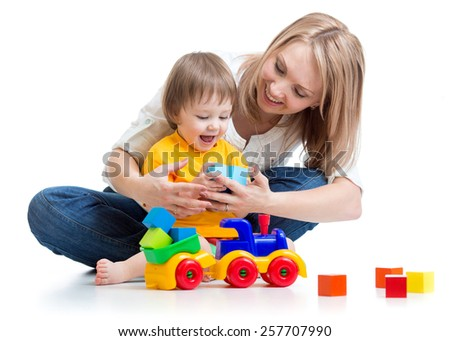 happy family - child boy and mom play with toys - stock photo