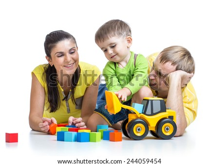 happy family - child boy and parents play building blocks