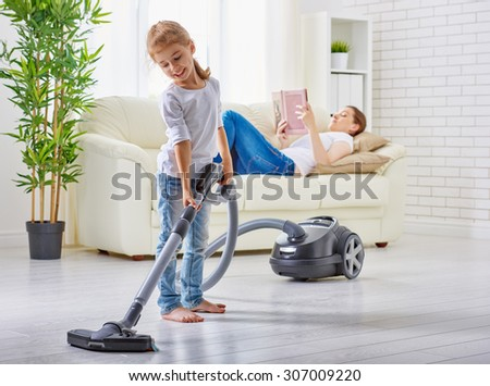 happy family cleans the room - stock photo