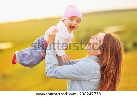 Happy family concept, mom and lovely daughter in summer day. - stock photo