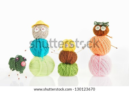 Happy Family. Conceptual Photo With Toys Made Of Balls Of Yarn - stock photo