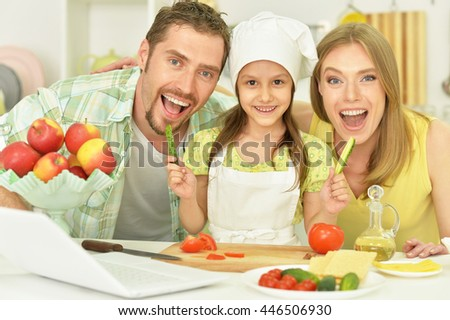 happy family cooking  in kitchen - stock photo