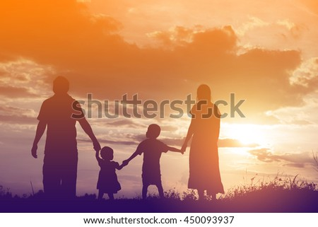 Happy family dancing on the road in the sunset time. Evening party on the nature