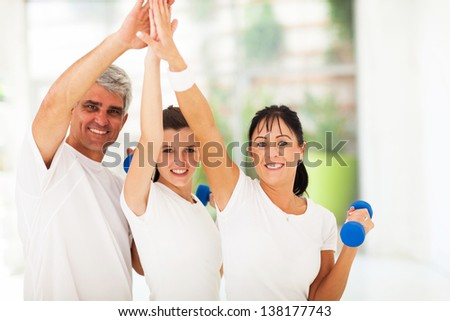 happy family doing high five after exercising at home