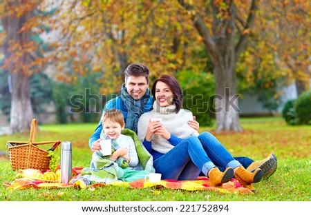 happy family drinking warm tea on autumn picnic - stock photo