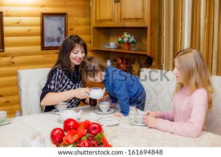 happy family drinks tea - stock photo