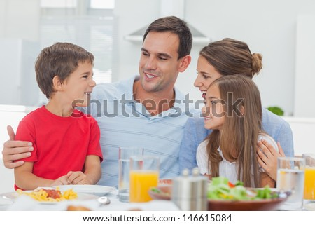 Happy family during the dinner at home at the table - stock photo