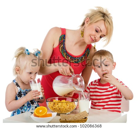 Happy family eating breakfast. isolated on white background - stock photo