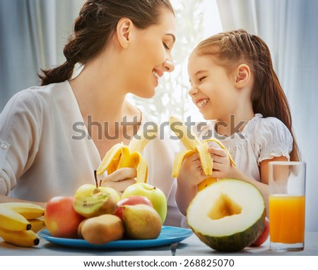 happy family eating fresh fruit - stock photo