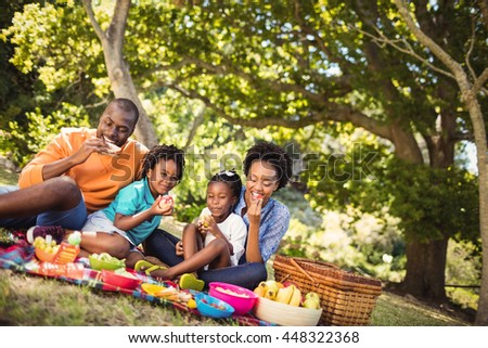 Happy family eating together at park