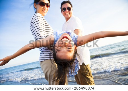 happy family enjoy summer vacation on the beach - stock photo