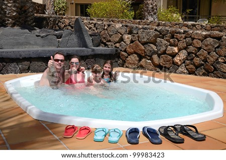 Happy family enjoy the tropical jacuzzi