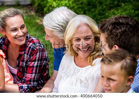 Happy family enjoying during picnic at park - stock photo