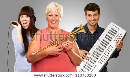 Happy Family Enjoying Music On Gray Background - stock photo