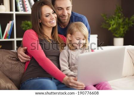 Happy family enjoying of modern technology - stock photo