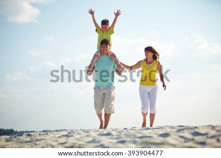 Happy family enjoying the time on the beach together