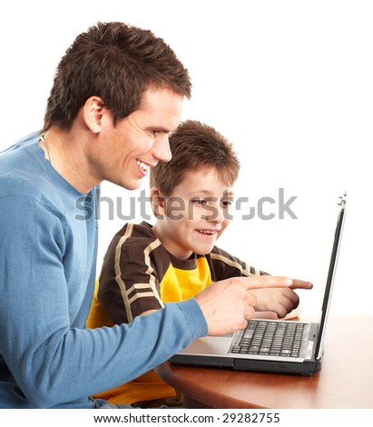 Happy family. Father and boy working with laptop. Over white background