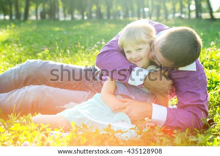 Happy family, father and daughter on nature - stock photo