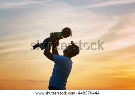 Happy family. Father and son playing outdoors. The concept of father's day. - stock photo
