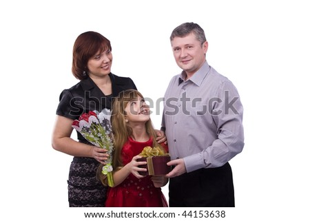 Happy family. Father is giving gifts daughter and mother. Man say happy birthday to girl and woman on white background. - stock photo