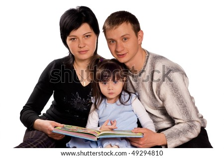 Happy family. Father, mother and child reading a book. Isolated on white background. Beautiful caucasian models.