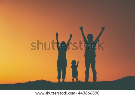 Happy family father mother and son playing outdoors at sunset silhouette.Vintage Tone.
