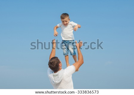 Happy family. Father throws up child in the sky, on sunny day the beach. Positive human emotions, feelings.