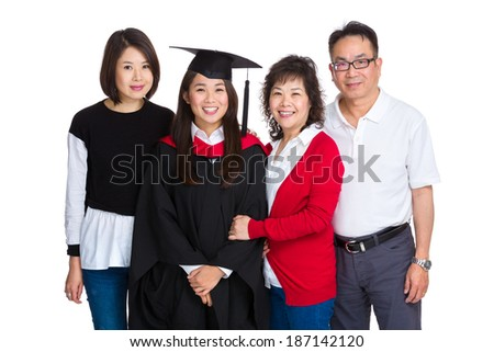Happy family gathered together with graduate student - stock photo