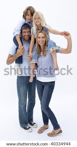 Happy family giving children piggy back ride against white background