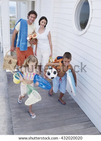 Happy family going to beach in vacation summer time - stock photo