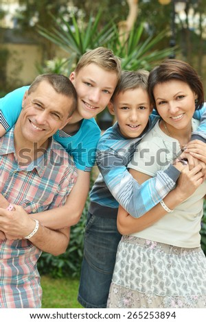 Happy family have fun at tropic hotel garden - stock photo