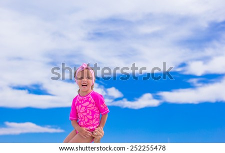 Happy family have fun during tropical beach vacation - stock photo