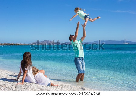 Happy family have fun on tropical beach