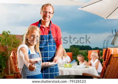 Happy family having a barbecue in summer