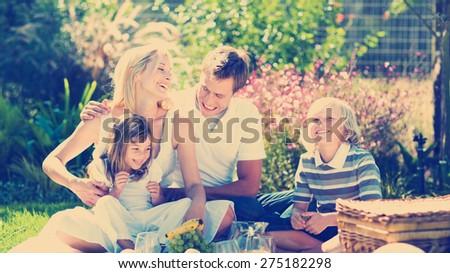 Happy family having a picnic - stock photo