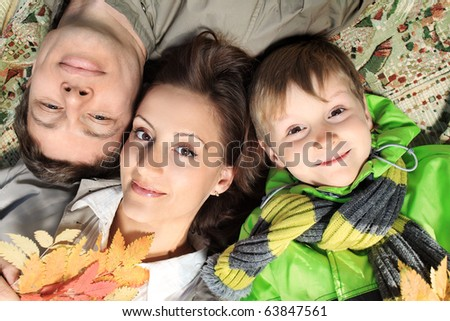 Happy family having a rest at the autumn park. - stock photo
