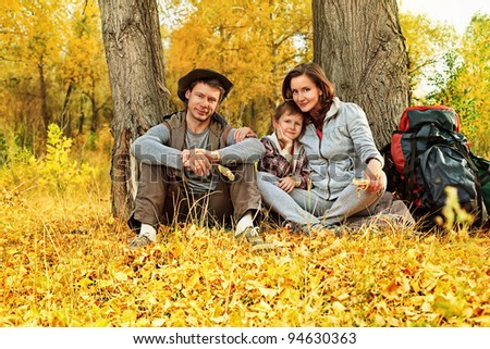 Happy family having a rest outdoor. - stock photo